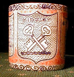 A mug painted about 1914 by Arthur Midgley of a crest crossed keys wards down.