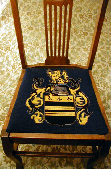 A chair embroidered with the Midgley Arms